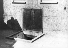Buchenwald, Germany, 1945, A door to the crematorium after the liberation.  Bodies were cast down this door, hung on hooks and brought up by elevator to be burned.