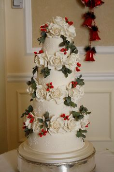 Sylvia's Kitchen | Dominique Four tier wedding cake at The Grand Hotel, Eastbourne, sugar roses, berries and foliage with hand piped snowflakes