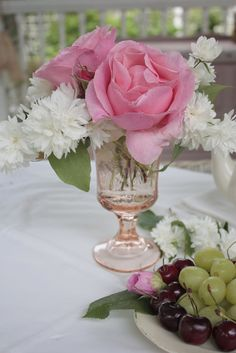 Roses in pink depression ware glass.