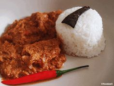 Indisches Butter Huhn Curry an Reis Indian buttered chicken curry with rice