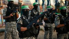 Hamas militants march during a rally in memory of people who were killed during a seven-week Israeli offensive, in Gaza City, Sept. 26, 2014.