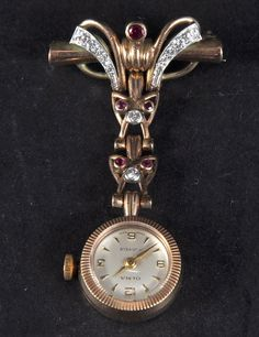 A Ladies 9ct Gold Olma Fob Watch Set With Rubies And Diamonds.