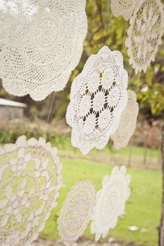 This could make a cute event back drop....Starched hanging doilies