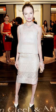 Kate Bosworth wearing a three-piece Monique Lhuillier ensemble, with an Edie Parker clutch and a selection of Van Cleef & Arpels' jewelry.