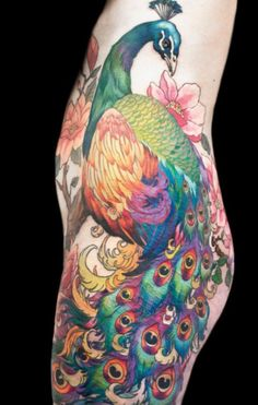 Colorful peacock body tattoo. http://blog.tattoodo.com/2014/04/40-enticing-peacock-tattoos/