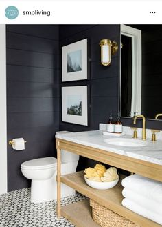 Dark walls, patterned tile and gold accents.