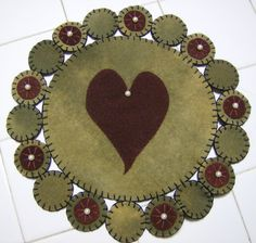 Primitive Heart Wool Penny Rug by QuiltgirlsCreations on Etsy, $25.00