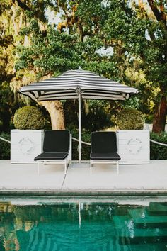 A poolside black and white striped shady oasis. Photography: Milou + Olin Photography
