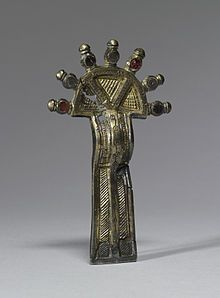 A 6th century bow fibula found in northeastern France and the Rhineland. They were worn by Frankish noblewomen in pairs at the shoulder or as belt ornaments.