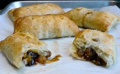 Puff Pastry Apple Hatch Hand Pies the perfect treat~T~ Wow a different apple pie. Golden raisins soaked in brandy, granny smith apples, some cayenne and a chili mustard. Strange and good.