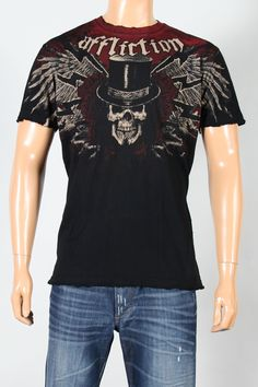 "Affliction® Mens ""Revolution Mother"" Signature Series Black T-Shirt  Affliction clothing has done it again, capturing to a Tee the aggressive punk style of ""Revolution Mother."" This stylized, hard-edge design features a signature skull rocking a top hat and a dangerous, welcome-to-my-nightmare smirk. The 100% cotton fabric has been finished with grinded edges for a well-worn distressed look.    SKU: A1959-BLACK         Short sleeve t-shirt.      Crew neck.      Signature Affliction…"