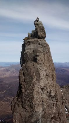 Roger's brother Andrew sitting on top of the Inaccessible Pinnacle. Skye's Cuillin Hills are such an incredible place to walk or climb!