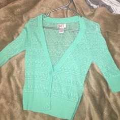 SO light blue/mintish color cardigan Has patterned cutouts. Super cute for a spring outfit. Size M. Worn once. SO Sweaters Cardigans