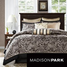 Madison Park Wellington 12-piece Bed in a Bag with Sheet Set for $149 at Overstock.com.  This is a quick and easy way to glam up your bedroom.  I love the paisley print and stripes together.  Please be aware that no thread count is given for the sheets, however,  I would purchase this set and buy black. platinum or silver sheets with a thread count of 300 or higher because this is a great comforter set.