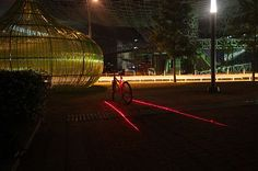 This laser device projects a bike lane that follows your bike as you ride.