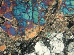 """Microfotografia. Hace 4.500 millones de años tuvo lugar una colisión a muy alta velocidad entre la Tierra y el """"embrión planetario"""" Theia cuyo resultado fue la Luna."""