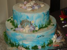 Life's+a+Beach+-+This+is+a+picture+of+a+cake+that+I+made+for+a+beach+theme+birthday+party.+Entire+cake+is+frosted+in+buttercream+and+has+chocolate+shell+&+MM+fondant+flower+accents.+This+was+really+fun+to+make.