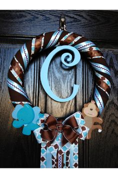 This turned out beautifully. highly recommend. // Inspiration design for precious hospital door wreath for boy (but doesn't look too frilly)! (Unfortunately doesn't link to instructions.)