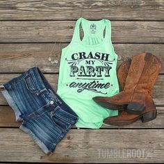 Cut offs, tanks, and boots. Perfect outfit :)