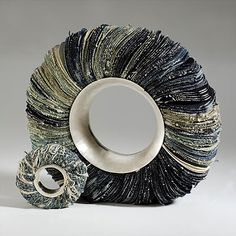 Bracelet |  Dorota Wisniewska  (paper? fabric?) combined with sterling silver.