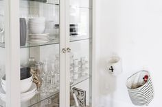 Scandinavian-inspired dining room - Ikea Stockholm glass cabinet | Happy Grey Lucky