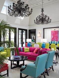 Turquoise chairs, yellow green chairs, fuchsia pink sofa, magenta sofa, black chandelier, white contemporary living and dining rooms