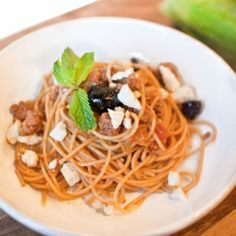 Hearty and healthy whole wheat pasta tossed with a ragu of lamb, leeks and shallots, topped with fresh mint, cured olives and feta cheese.