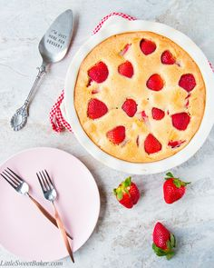 This easy 4 ingredient fresh strawberry cake is delicious and loaded with chunks of tasty strawberries.