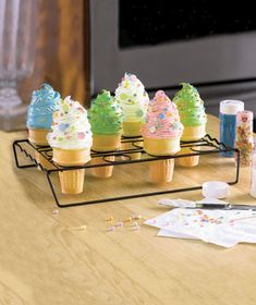 Bake and display a delicious new take on a traditional dessert using this Cupcake Baking Rack. The metal rack features a nonstick surface and slots for 12 medium and large cupcake cones. Just use your own cake batter to fill the cones and pop the rac Make Ice Cream, Ice Cream Party, Cupcake Cones, Cupcake Ideas, Cupcake Party, Cookie Ideas, Cupcake Recipes, Dessert Recipes, Large Cupcake