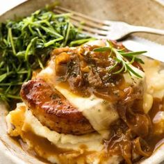 French Onion Smothered Pork Chops French Onion Smothered Pork Chops on mashed potato with a side of sautéed snow pea sprouts Seared Pork Chops, Juicy Pork Chops, Pork Steaks, Pork Chops And Gravy, Pork Recipes, Cooking Recipes, Healthy Recipes, French Food Recipes, Easy Pork Chop Recipes
