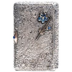 Faberge Silver Gold Cigarette Case | See more rare vintage Boxes and Cases at https://www.1stdibs.com/jewelry/objets-dart-vertu/boxes-cases