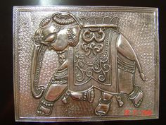 Pewter elephant on a jewelry box