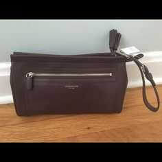 NWT Coach classic brown leather clutch NWT brown leather Coach clutch. Classic wardrobe staple, has wrist strap, front  zipper pocket on outside, tassels zip at top too Coach Bags Clutches & Wristlets