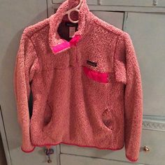 RARE PATAGONIA RETOOL RARE and Hard to Find Patagonia Retool sweater in hot pink and super soft material! In excellent PRELOVED condition! I purchased this PRELOVED and I've worn it once, but I would prefer a large because my arms are just too long! Looks awesome and is SO warm!!!  Patagonia Sweaters