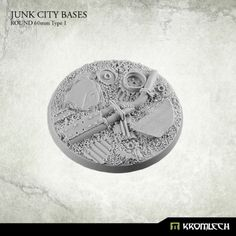 This set contains 1 round 60mm scenic base. Junk City theme.