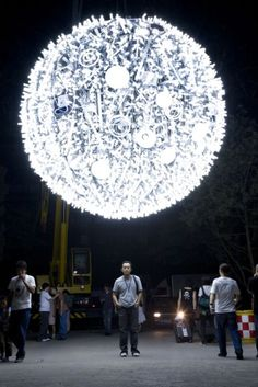 Artificial Moon. Beijing-based artist Wang Yuyang's Artificial Moon may resemble the famous Waterford Crystal Times Square New Year's Eve Ball, but it's meant to be a magnificent recreation of Earth's only moon. Constructed from hundreds of compact fluorescent lightbulbs and at over 13 feet wide, the massive moon even has strategically placed lights to mimic the real moon's craters and surface features.