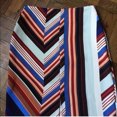 """Top shop striped pencil skirt Embrace the '70s trend with this multi-colured midi skirt. The deckchair style split pattern features vertical stripes and a chevron print for added edge to your wardrobe! 25"""" L and 9.75"""" slit. Side zip and hook and eye closure. Topshop Skirts Midi"""