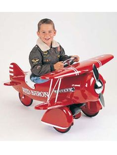 Airflow Red Baron Kids Pedal Plane .I want a pic of Logan on his air plane like this so cute!