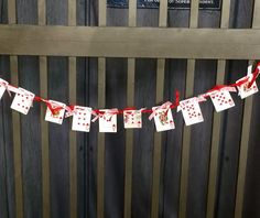 Use a thrifted deck of cards to create a fun Valentine's Day mantle or door swag. Use the heart suit, punch two holes in the top two corners and thread ribbon through. Fun and thrifty!