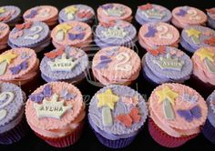 Pink and purple fondant cupcakes for an princess themed 2nd birthday party! All cupcakes handcrafted by Little Creations By Rose. www.facebook.com/LCByRose