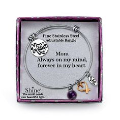 """Shine Silvertone: Honor your mom every time you wear the """"Mom Always on My Mind, Forever in My Heart"""" Charm Bangle by Shine. Crafted of sleek stainless steel, this beautiful bangle features four unique charms that celebrate your mom's influence on your life."""