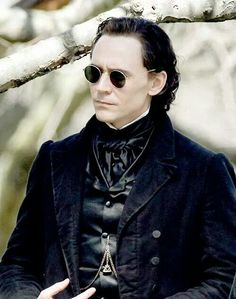 Tom Hiddleston wearing vintage shades in Crimson Peak.