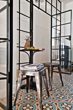 fabulous moroccan Encaustic Cement Tiles in a black and white kitchen with some…