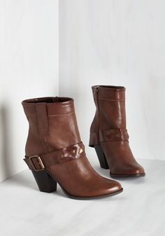 Salt Lake City Slicker Bootie in Whiskey. Strut down the sidewalk with prowess over the metropolis in these brown booties from Dolce by Mojo Moxy! #brown #modcloth