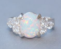 Lab Created Opal & Cubic Zircnoia by hangingbyathread1 on Etsy