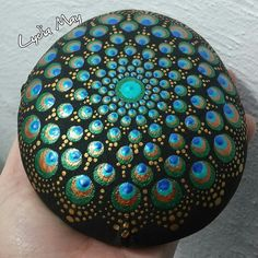 """Mandala actually is a sacred pactice enganged by Tibetan monks and many other cultures. Mandala words originated from classical Indian Sanskrit languange that could be losely means a """"circle"""". Here is DIY Mandala Rock Painting Mandalas Painting, Peacock Painting, Dot Art Painting, Pebble Painting, Pebble Art, Stone Painting, Mandala Painted Rocks, Mandala Rocks, Hand Painted Rocks"""