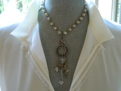 Religious Medals Assemblage Necklace. $65.00, via Etsy.
