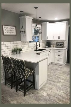 Modern farmhouse kitchen ideas on a budget - gorgeous farmhouse kitchen decorating ideas for a small rustic country farmhouse kitchen. LOVE the wood floors and subway tile and the hanging lights in this modern farmhouse style kitchen!