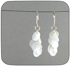 these earrings are made from plastic milk jug. I like the idea of turning plastic into capiz shells.