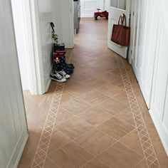 Karndean Jura Knight Tile Vinyl Flooring has a linear pattern with mid brown hues which look great when tesselated with a contrasting grouting strip to define each tile. The strip displayed between tiles is design strip. Kardean Flooring, Entryway Flooring, Luxury Vinyl Tile Flooring, Flooring For Stairs, Flooring Ideas, Karndean Knight Tile, Tiled Hallway, Kitchen Vinyl, Hallway Decorating